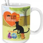 orange cat kneads me mug