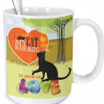 orange cat kneads me mug